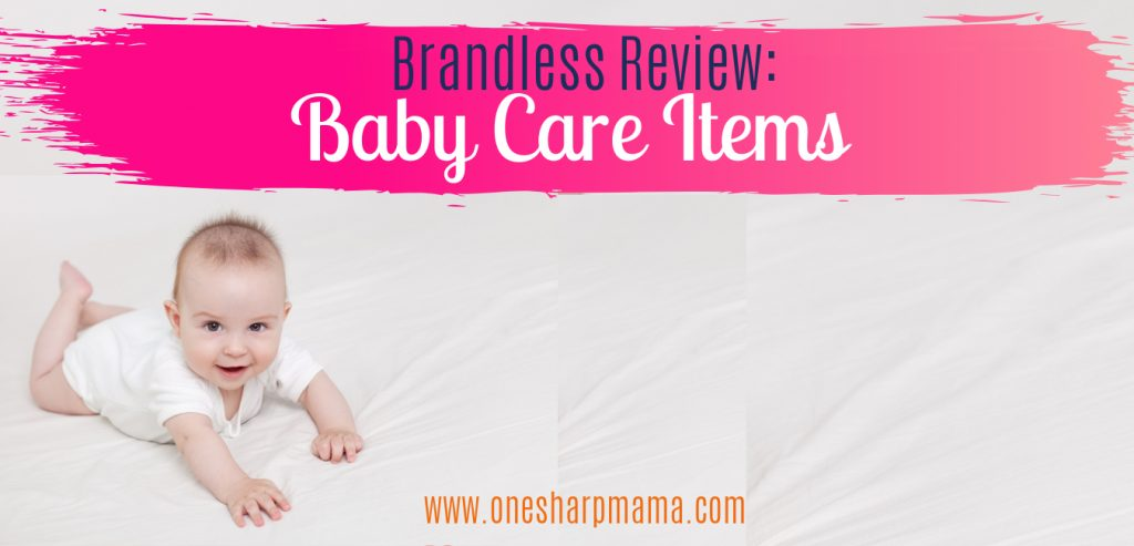 brandless review baby care items text on a pink gradient banner with a baby on a blanket.