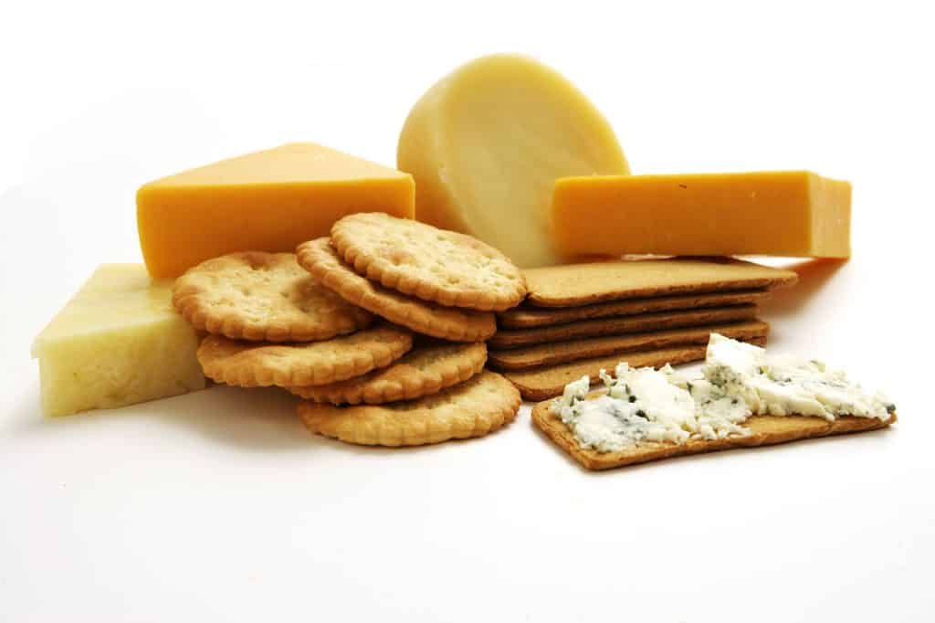 A collection a various types of cheeses and crackers- an easy snack idea.
