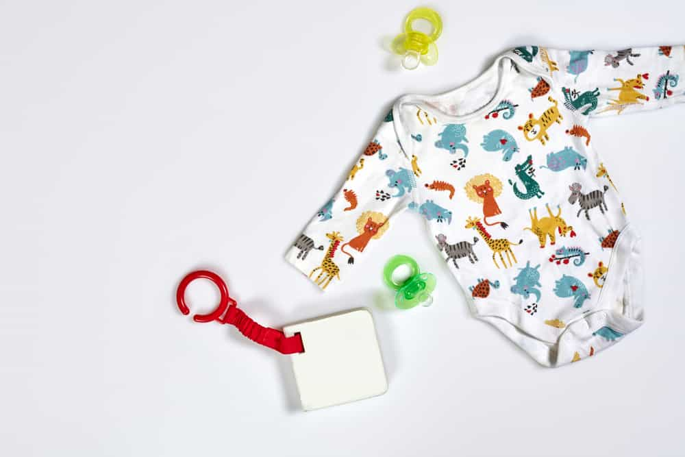 When to buy baby stuff such as the baby onesie, pacifier and baby toy in the image.