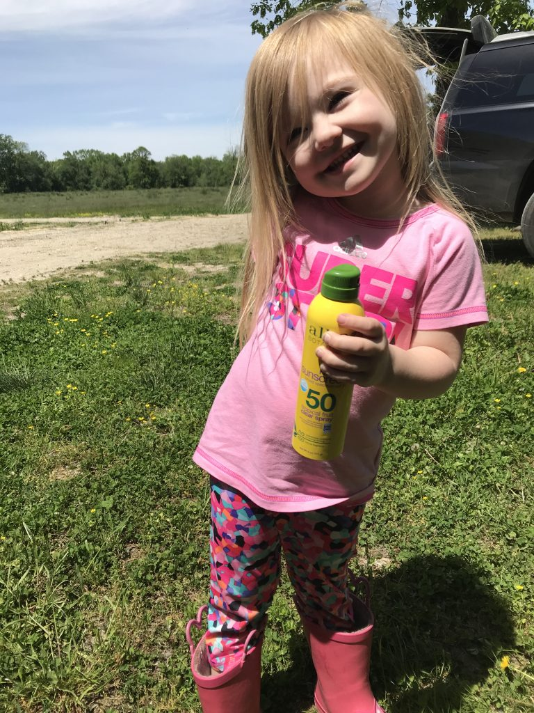 kid with Alba Botanica sunscreen