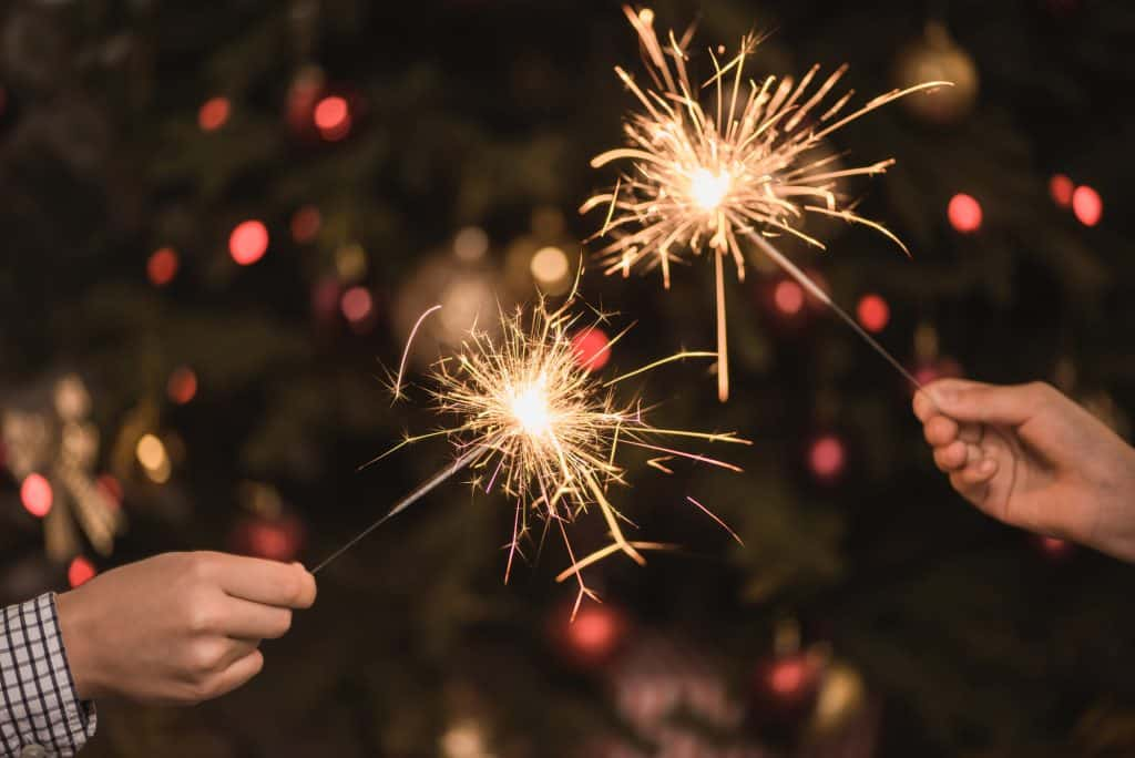 Sparklers in 2 hands.