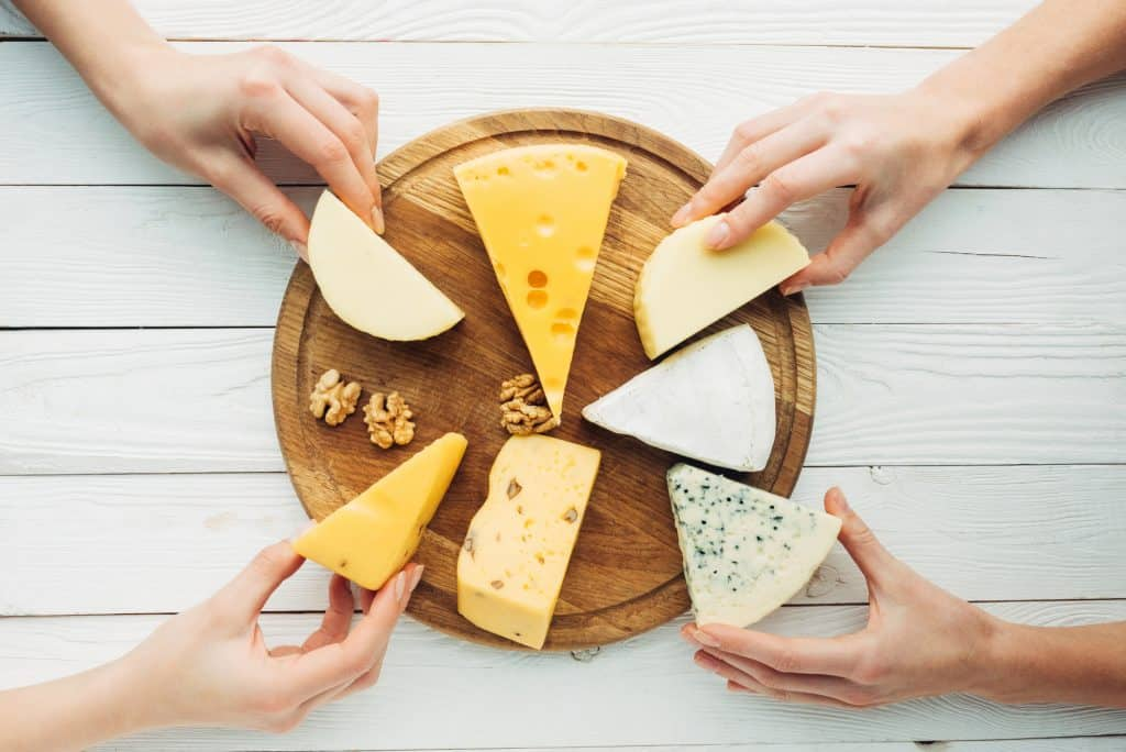 Cutting wheel with cheeses.