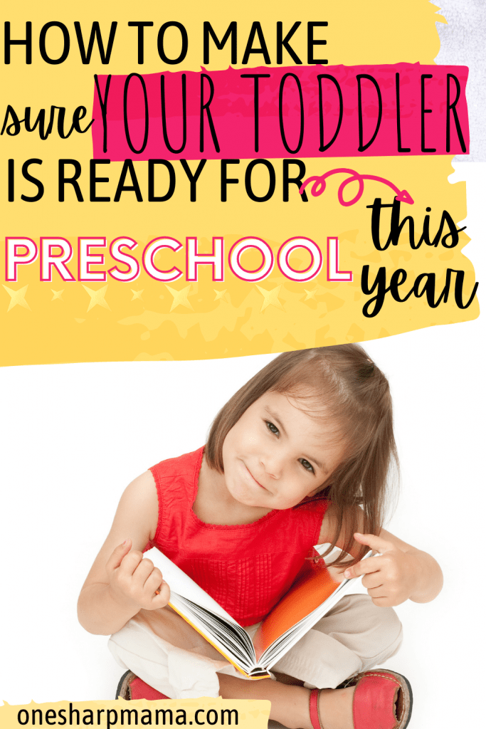 Toddler sitting looking at book with text overlay that says How to be sure your toddler is ready for preschool this year.