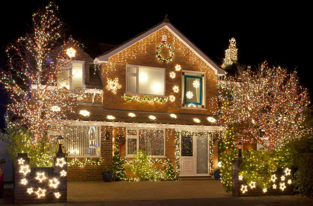 House lit up with Christmas light decorations.